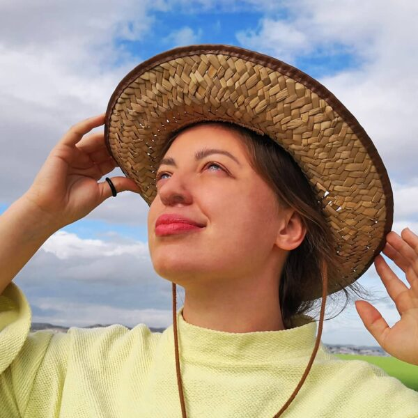 nose filter girl wearing hat breathing no dust closeup